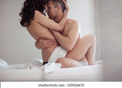 Nude couple on bed fuck